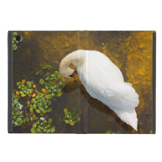 Two swans with sun reflection on shallow water. iPad mini case