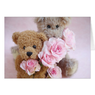 two teddy bears holding roses greeting card