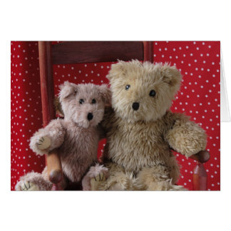 two teddy bears in a red chair greeting card