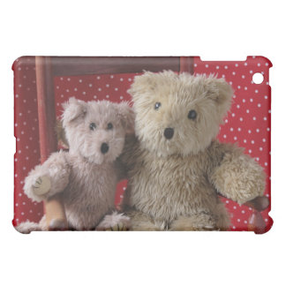 two teddy bears in a red chair iPad case