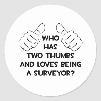 Two Thumbs and Loves Being a Surveyor Round Sticker