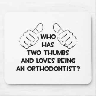 Two Thumbs and Loves Being an Orthodontist Mouse Pad