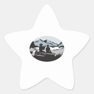 Two Trampers Sitting on Log Lake Mountain Oval Woo Star Sticker