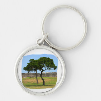 Two trees and castle walls Silver-Colored round keychain
