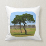 Two trees and castle walls throw pillows