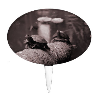 two turtles on palm trunk sepia cake topper