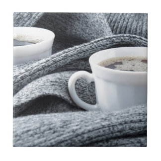 Two white cups of coffee wrapped in scarf ceramic tile