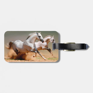 two white horses running bag tag