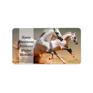 two white horses running label