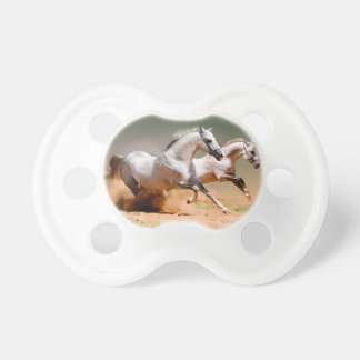 two white horses running pacifier