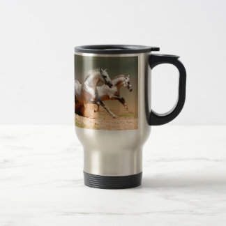 two white horses running travel mug