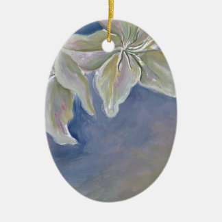 two white lilies on blue ceramic ornament