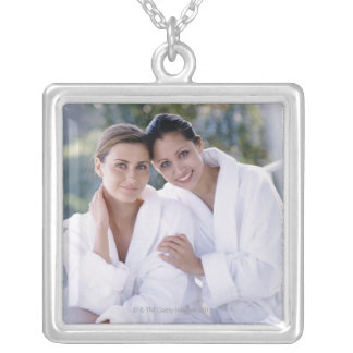Two woman wearing bath robes square pendant necklace