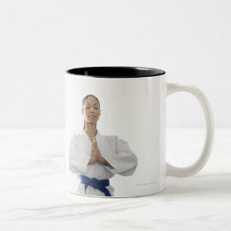 Two women meditating Two-Tone coffee mug