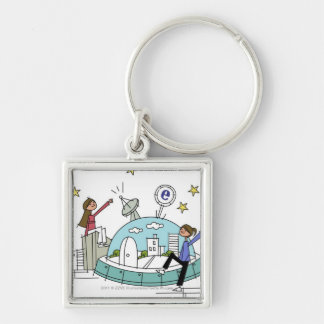 Two women sitting on top of a city keychain