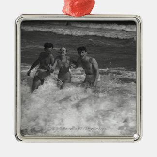 Two young men and woman playing in wave B&W Metal Ornament