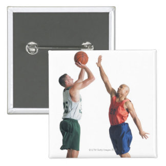 two young men dressed in opposing team pinback buttons