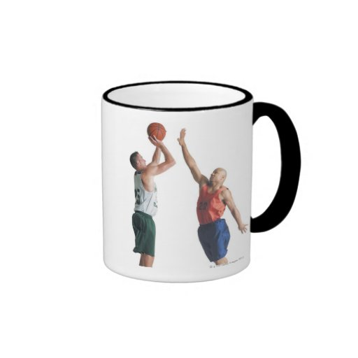 two young men dressed in opposing team coffee mugs