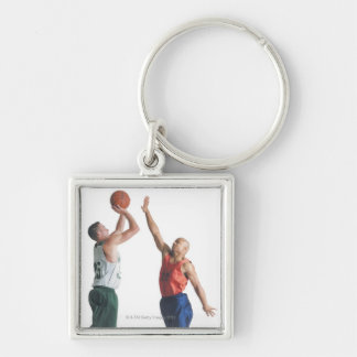 two young men dressed in opposing team keychain