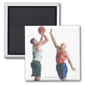 two young men dressed in opposing team fridge magnets