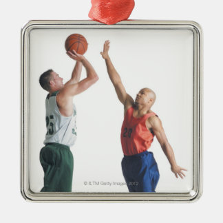 two young men dressed in opposing team metal ornament