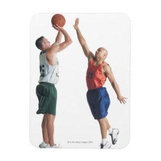 two young men dressed in opposing team vinyl magnets