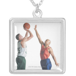 two young men dressed in opposing team square pendant necklace