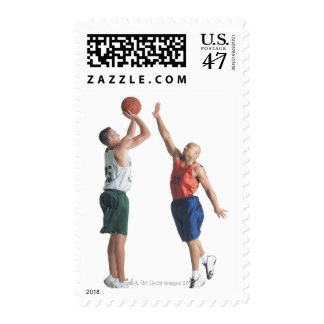 two young men dressed in opposing team stamp
