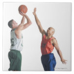 two young men dressed in opposing team ceramic tile