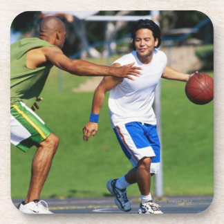 Two young men playing basketball beverage coaster
