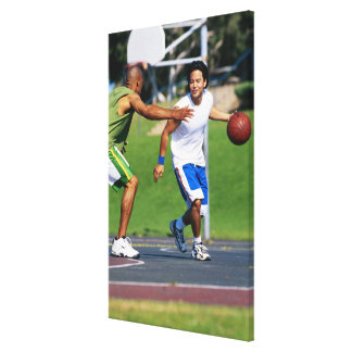 Two young men playing basketball canvas print