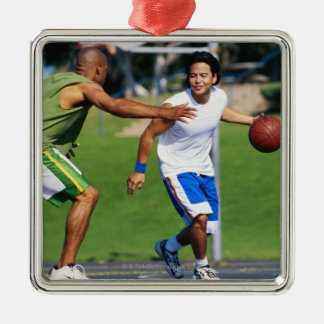 Two young men playing basketball metal ornament