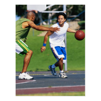 Two young men playing basketball postcard