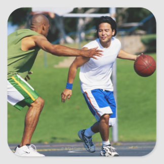 Two young men playing basketball square sticker
