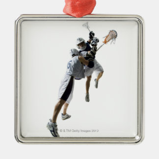 Two young men playing lacrosse 2 metal ornament