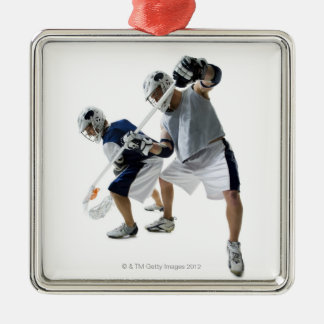 Two young men playing lacrosse metal ornament