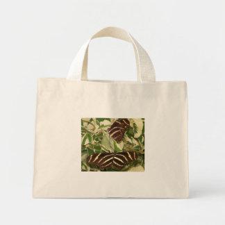 Two zebra butterflies on foliage mini tote bag