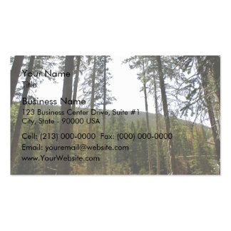 Typical hillside with lot of tall trees business card