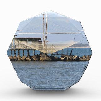 Typical italian fishing net along the river award