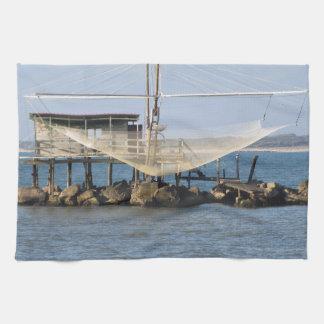 Typical italian fishing net along the river hand towel