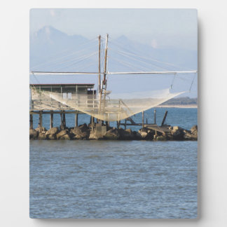 Typical italian fishing net along the river plaque