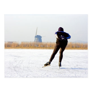 Typically dutch: ice skating on a frozen lake postcard