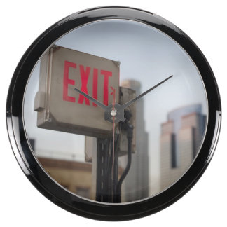 typically exit sign glows bright in the blue aqua clock