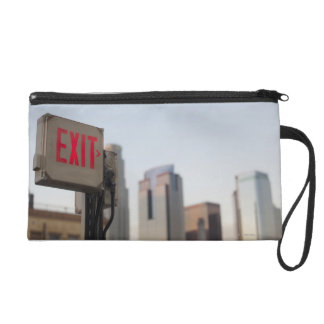typically exit sign glows bright in the blue wristlet purse