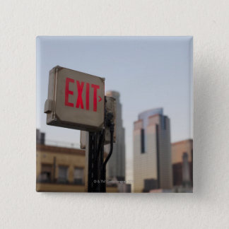 typically exit sign glows bright in the blue pinback button