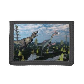 Tyrannosaurus rex attacking gigantoraptor dinosaur trifold wallet
