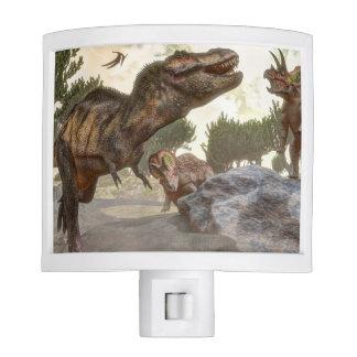 Tyrannosaurus rex escaping from triceratops attack night light