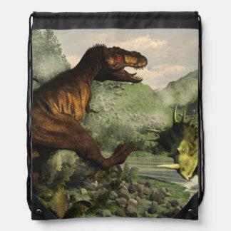 Tyrannosaurus rex fighting against styracosaurus drawstring bag