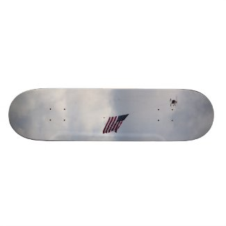U.S.A flag carried by a helicopter on a skateboard