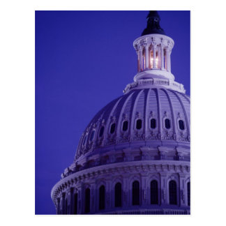 U.S Capitol at dusk with light in dome on Postcard